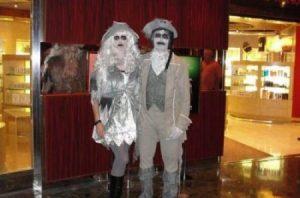 Couple Dressed As Zombie Pirates